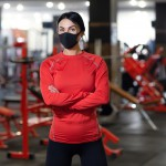 Coronavirus,Covid-19,Prevention,,Fitness,Girl,With,A,Medical,Mask,Posing