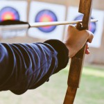 Archer,Holds,His,Bow,Aiming,At,A,Target